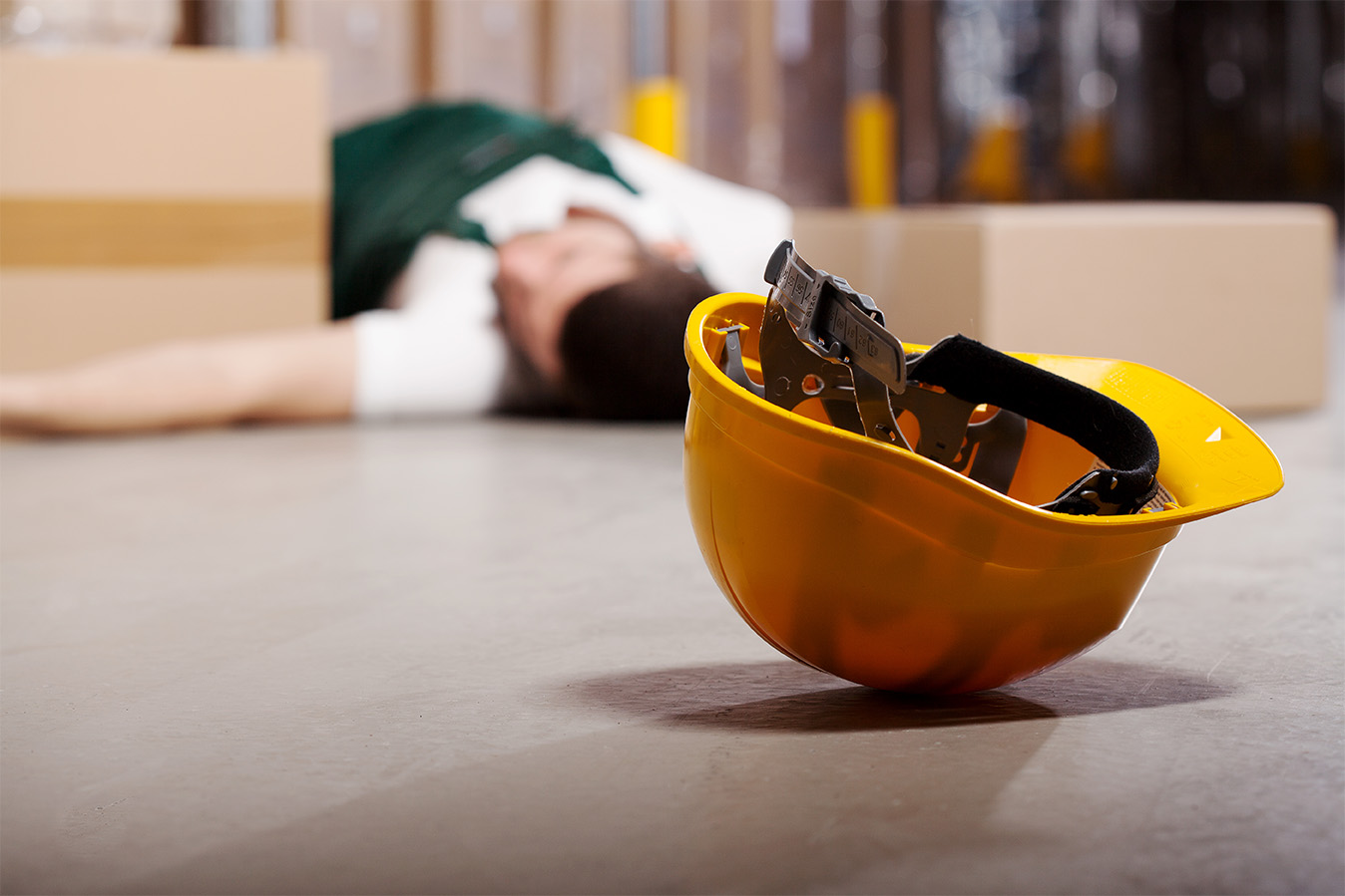 Man on the floor after workplace accident