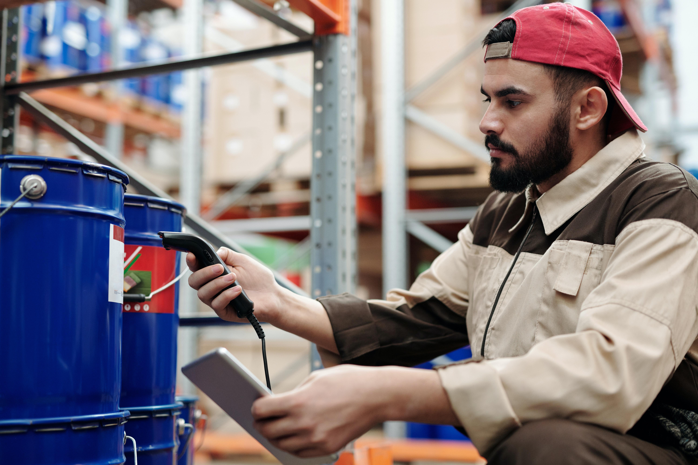Warehouse worker using digital EHS system